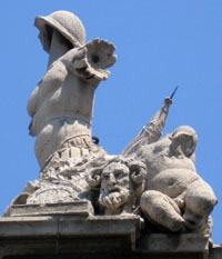 Grisly statue adorning an elaborate arch in Catonia on Sicily.