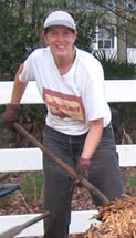 Ginny Stibolt shoveling mulch for her garden.  Photo by Stibolt