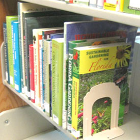 Ginny's book, Sustainable Gardening for Florida is on her library's bookshelf.  Photo by Stibolt.
